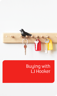 Buying with LJ Hooker banner - keys hung on hooks